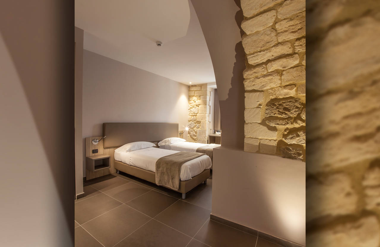 Soft colours and delicate hues envelop the bedrooms and bathrooms in a project combining the traditional and the contemporary